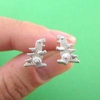 Small Godzilla Shaped Dinosaur Stud Earrings in Silver | DOTOLY