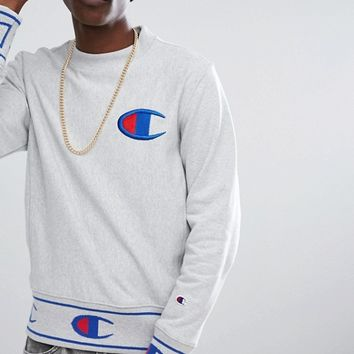 Champion Sweatshirt With Repeat Logo Cuff at asos.com
