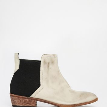 Free People Dark Horse White Flat Ankle Boots at asos.com