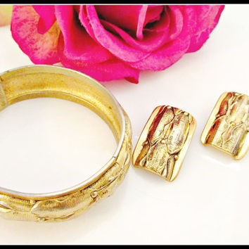 Whiting and Davis Gold hinge bracelet and Clip on earrings gold repousse leaf design