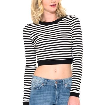 This long sleeve cropped top features a lightweight ribbed knit fabrication, black and white stripe print throughout, round neckline, and crop hemline. Pair with high waist skirt, dark blue denim bell bottom or high waist denim cut off and floppy hat.