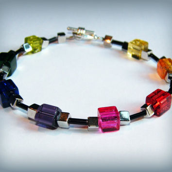 Rainbow and black glass bead bracelet with a toggle clasp