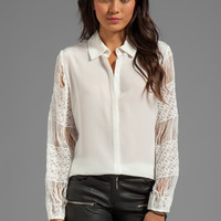 Alexis Aleksandra Button Down Blouse With Crochet Sleeves in White from REVOLVEclothing.com