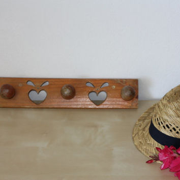French vintage little wooden coat rack with 3 hooks, with a sculptured pattern.