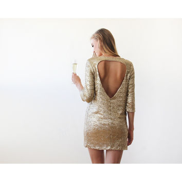 Swanky gold sequins dress with open back