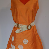 Peach, orange, belted summer dress with appliqués