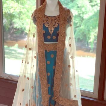 Women's custom embroidered sari of silk blend.