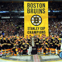 The Boston Bruins raise their 2011 Stanley Cup Chapionship Banner Photo at AllPosters.com