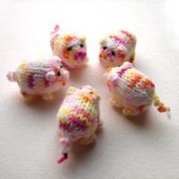 Girly piggy knitted baby toy, little pigs stuffed toy white with yellow, pink and orange spots