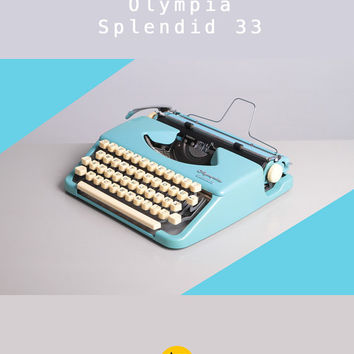 1950's Olympia Splendid 33 Typewriter. First version. Excellent working condition. Portable. Deep sky blue. With Case.