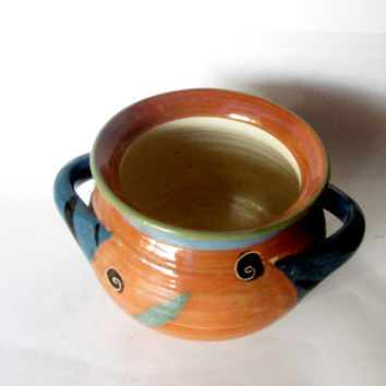 Ceramic handmade deep bowl with two handles. Pottery bowl. Unique design. Rural style. Blue and brown.