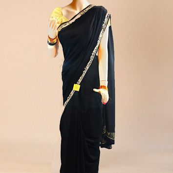 the crepe silk saree in cool black with thin cream border