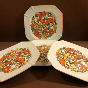 """Set of Four Retro, Hippie, Mod 7.5"""" Dessert or Salad Plates with Orange Mushrooms, Yellow Flowers and Green Leaves."""