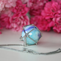 Geometric necklace with blue marbles in a metal geometric cage. Chain necklace