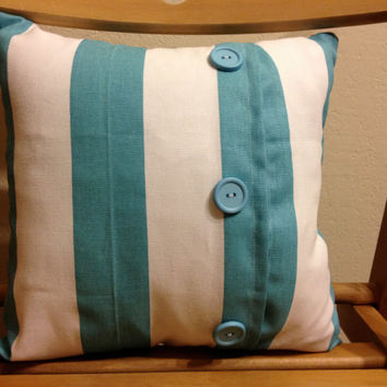 Blue and white throw pillow with matching buttons - 12 by 12 inches