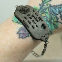 Mantra bracelet The most wasted of all days is one with out laughter grey leather
