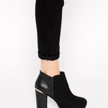 River Island | River Island Para Gold Metal Trim Ankle Boots at ASOS