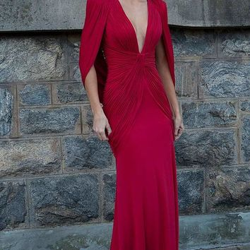 Red jersey long dress with a plunging neckline and padded shoulders.