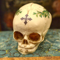 Painted Fetal Skull replica  - real size resin fetus skull with sacred cross and laurel wreath - Goth Oddity home decor or craft supply. -