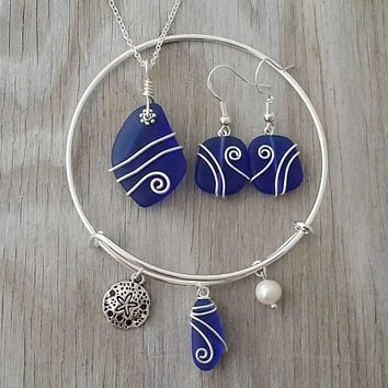 Handmade in Hawaii, Wire wrapped cobalt blue sea glass necklace + earrings + bracelet jewelry set, Sand dollar charm, Sterling silver chain.