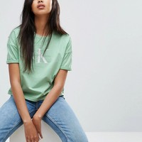 Calvin Klein Jeans Cropped Logo Top at asos.com