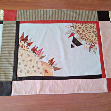 Patchwork table runner with appliques and embroideries. Beige and red country table runner