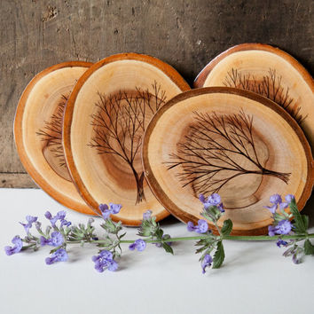 Set of 4 Rustic, Modern Wood Slice Coasters with Wood Burned Tree Designs. Oval shape.
