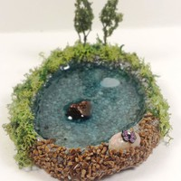 Miniature pond. Fairy garden accessories, dollhouse, terrarium décor. With trees, rocks, moss, and butterfly.