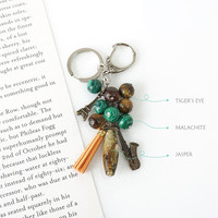 Saxophonist Keychain / Bagcharm, Made of Jasper, Malachite, Tiger's Eye Stones, Saxophone and Eiffel Tower Charms