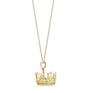 Tiffany & Co. -  Crown charm in 18k gold on a chain.