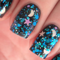 "Nail polish - ""Falling Skies"" stars and moons with blue, teal and violet glitter in a clear base"