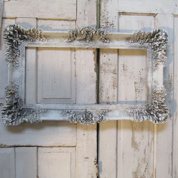 French farmhouse large frame ornate wall decor painted in white and gray distressed antique aged style frame anita spero