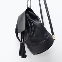 Bucket backpack with tassel