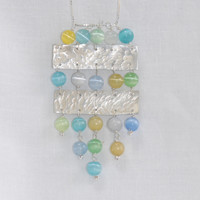 Silver and blue green cat's eye glass necklace