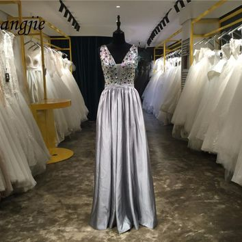 Custom Made A-line Crystals Prom Dresses 2018 Deep V-Neck Sleeveless Backless Floor Length Evening Party Formal Gowns