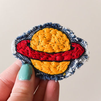 Embroidered Chuckie Finster Saturn Patch on Denim