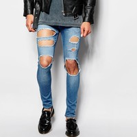 ASOS | ASOS Extreme Super Skinny Jeans With Extreme Open Rips at ASOS