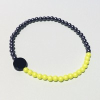 [P.G.] one onyx and pearl bracelet