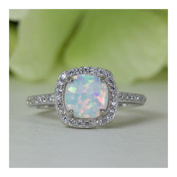 Halo Cushion Cabochon Lab-Created Opal With Fine Quality Cubic Zirconia Ring in Sterling Silver
