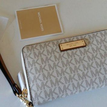 DCCKB7E Bnwt Michael kors jet set Large Flat Multifunction Phone Case Wristlet vanilla