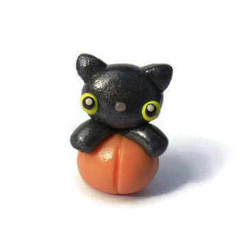 Halloween black cat in a pumpkin sculpture, miniature figurine, kawaii kitten, polymer clay, home decor, festive decoration, autumn, manga