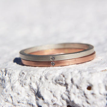 Thin delicate rose gold and silver stacking bands.  Flush set 1mm eco-friendly diamonds. Wedding or engagement ring, anniversary, or holiday