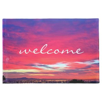 """Welcome"" hot pink & blue sunrise photo doormat"