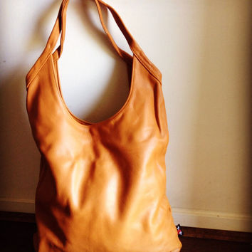 Genuine Leather, super soft, slouchy designer handbag. Our Sac has two straps and a is a deep and generous size. Timeless shape.