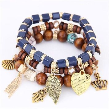 Exquisite Set of 4 Blue Wood Stretch Charm Bracelets with Feather Shell Hamsa Heart and Crown Charms