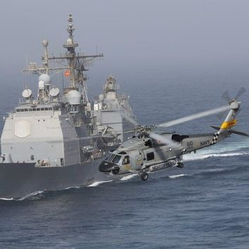 A SH-60J Seahawk flys by USS Vicksburg during a vertical replenishment Poster Print (16 x 12)
