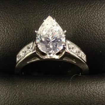 Cubic Zirconia Engagement Ring-*Clearance* The Audra (Pear Cut Center and 7-stone Princess Channel in Palladium)
