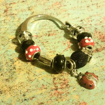 Ladybug Bracelet with red and black beads