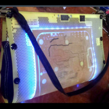 Electro purse made from upcycled materials. Custom illuminated bags!