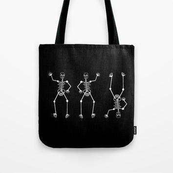 White skeleton on black Tote Bag by Zia